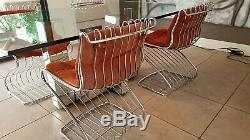 Gaston Rinaldi for Rima set of four chrome dining chairs made in Italy 1960's